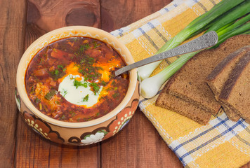 Bowl of Ukrainian borscht garnished with dill and sour cream