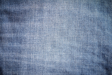 Closeup denim jeans texture. Stitched textured blue denim jeans background. Old grunge vintage denim jeans. Denim jeans fashion design.