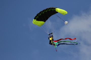 Skydiver with South African flag coming into land