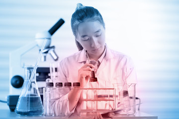female medical or scientific researcher or woman doctor thinking