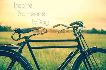 beautiful landscape image with Bicycle at sunset in vintage tone style ; life quote. Inspirational quote. Motivational background
