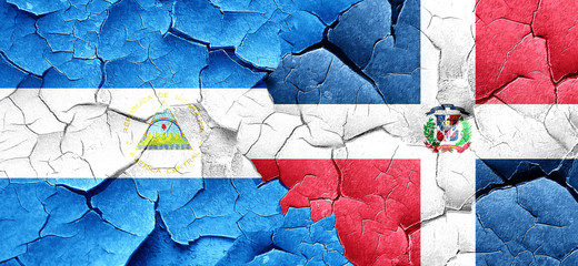 nicaragua flag with Dominican Republic flag on a grunge cracked