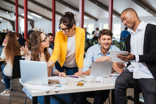 Group of smiling business people working together in office