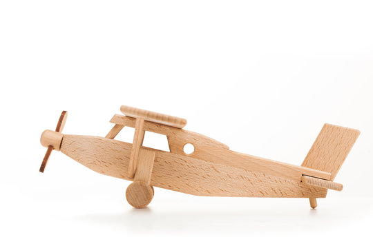 Retro wooden airplane isolated on white background