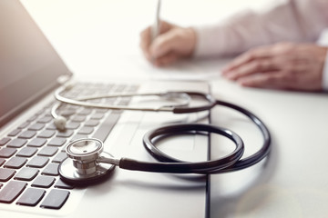 Doctor writing prescription or medical examination notes