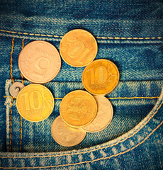 Coins and pocket jeans