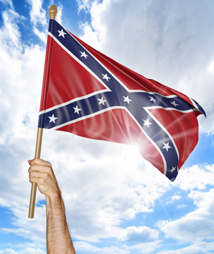 Person's hand holding the Confederate States flag and waving it in the sky, part 3D rendering
