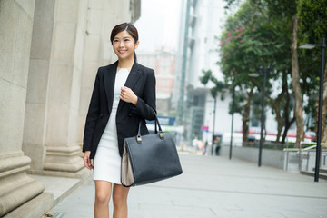 Businesswoman carry a bag and leaving office