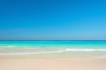 Wall Mural - Breathtaking turquoise sea, Exotic beach with gentle wave and clear, Ripple wave and clear on beac with blue sky