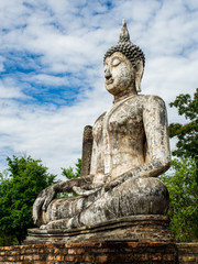 Buddha statue at Wat Traphang Ngoen, an ancient temple in Sukhothai Historical Park, Sukhothai, Thailand.