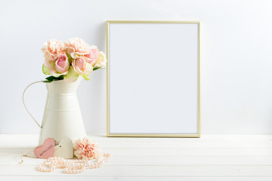 Mockup styled stock photograph of cream jug of flowers next to a Gold frame. You can place your business promotion, blog title, quote, headline or image in the frame.