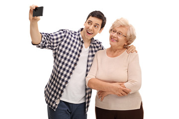 Man taking selfie with his grandmother