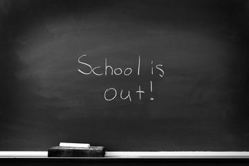 Chalkboard with School is Out Sign