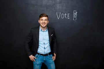 picture of suited man near text vote