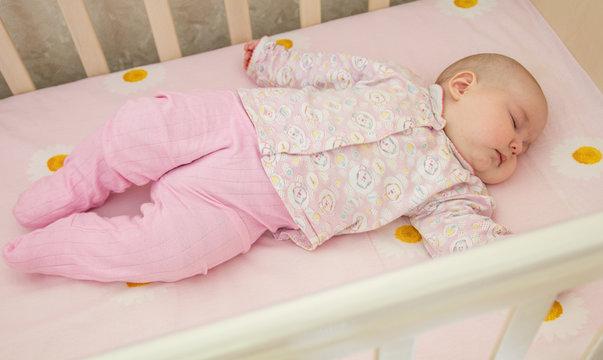 Very nice sweet baby sleeping in crib