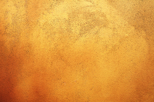 Яркий светлый оранжевый фактурный абстрактный фон стены