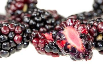Pile of Blackberries isolated on white background. Blackberry background