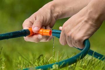 hands connected garden hose