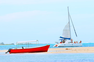 Printed roller blinds Water Motor sports Red motor boat and catamaran on Indian Ocean near Ile Aux Cerfs Island ( Mauritius Island). Blue sea and beach in tropical paradise.