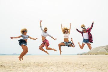 Attractive females having fun at beach.