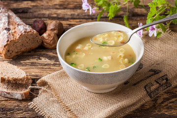 Vegetable soup on a rustic wooden table