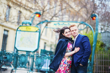 Romantic couple in Paris near metro station