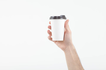 hand holding coffee paper cup