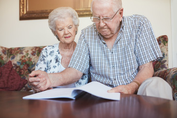 Mature couple going through some retirement paperwork