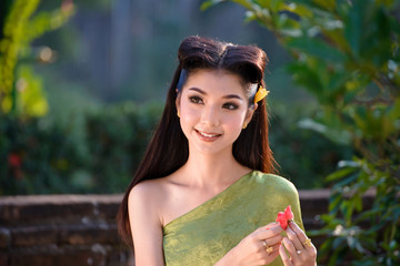 Portrait Of Beautiful Woman Wearing In Thai Traditional Costume