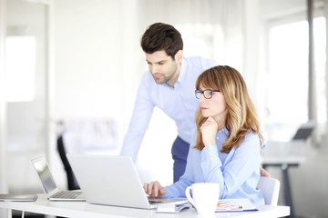 Business team working together on laptop at office