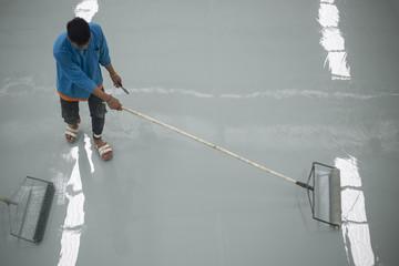 A worker application of epoxy floor