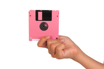 Holding floppy disc on white background. Computer floppy disk in hand.