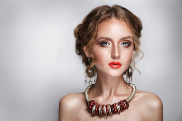 blond hair beauty woman portrait wears golden ear-rings and necklace