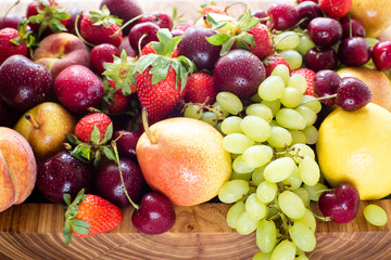 Fresh mixed fruits, berries background.Healthy eating.Love fruit, diet.