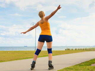 Young woman rollerblading outdoor on sunny day