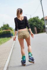 beautiful young woman rollerskating