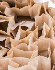 Brown paper disposable bags in the pile