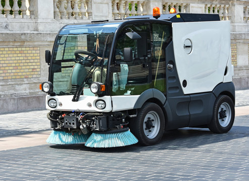 Street cleaner vehicle at work