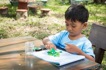 Little kids do homework arts in green park