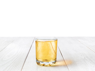 a glass of Apple juice on the white Desk isolated on white backg