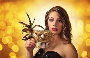 Beautiful woman with gold carnival mask
