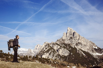 Hiker photographer on a mountain top