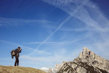 Hiker photographer taking photos on a mountain top
