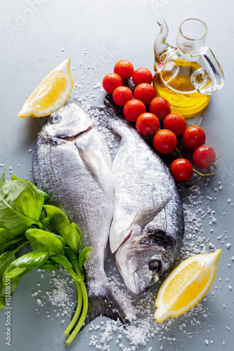 Delicious two fresh fish with aromatic herbs spices and for Aromatic herb for fish