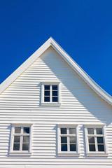 White wooden house gable against blue sky