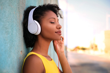Pretty girl listening music with her headphones