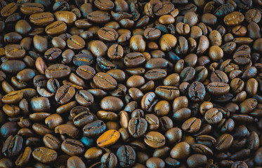 Close-up of brown coffee beans for background and texture