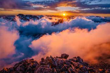 Sunset across cloud covered mountains