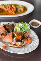 Steamed blue crabs cut in half put on white dish. Selective Focu