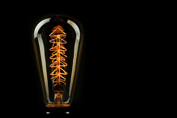 Illuminated light bulb on black background